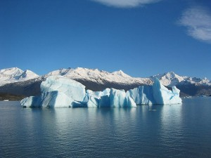 an iceberg and glacier out at sea